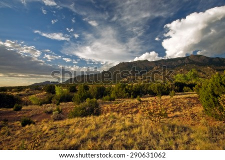 The beautiful Sandia Mountains and surrounding desert at sunset, right outside of Albuquerque, New Mexico. - stock photo