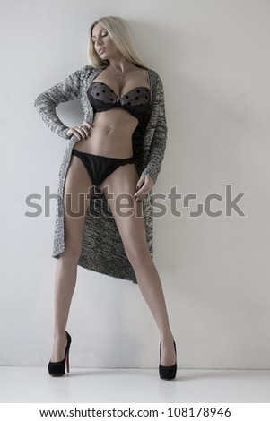 The beautiful sexual woman in underwear and in a knitted dress. Fashion art photo - stock photo