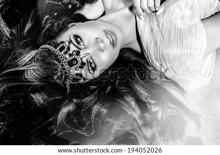 the beautiful sexy strict woman with long hair. Fashion model posing at studio - stock photo