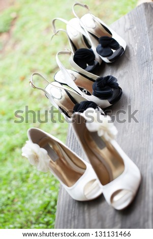 The beautiful shoes of the bride with flowers on the side. - stock photo