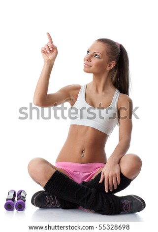 The beautiful sports girl with dumbbells on a white background. Fitness. - stock photo