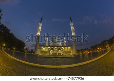 The beautiful Sultan Salahuddin Abdul Aziz Shah Mosque (also known as the Blue Mosque) located at Shah Alam, Selangor, Malaysia at dusk