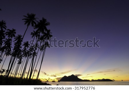 The Beautiful Sunrise at Maiga Island, Semporna, Sabah, Borneo, Malaysia Image has grain or blurry or noise and soft focus when view at full resolution. (Shallow DOF, slight motion blur) - stock photo