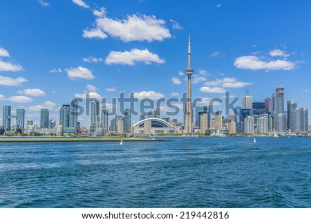 The beautiful Toronto's skyline with CN Tower over lake. Urban architecture. Canada.