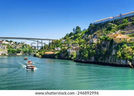 The beautiful view of the Douro River  in Porto, Portugal. Porto is one of the most popular tourist destinations in Europe. - stock photo