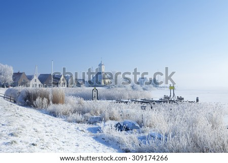 The beautiful village of Durgerdam in The Netherlands along the Markermeer in winter. - stock photo
