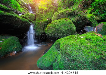 The beautiful water cascades over moss covered rocks, rainforest waterfall at Phu Soi Dao National Park, Thailand. - stock photo