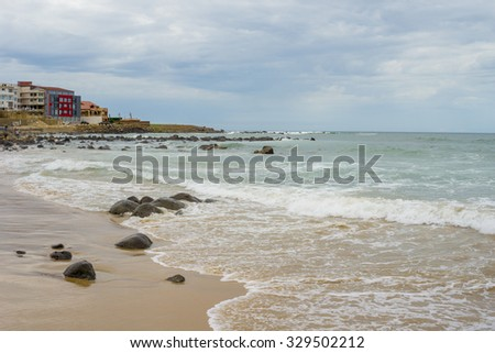 The beautiful waters of the Atlantic ocean with its rocky coastline near the City of Dakar in Senegal - stock photo