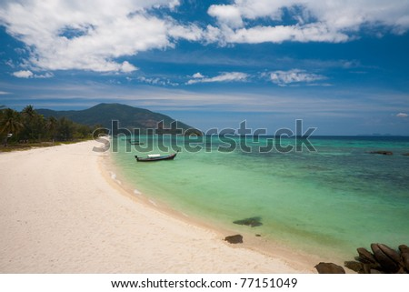 The beautiful white sand beach and blue turquoise water on Koh Lipe (Ko Lipeh) Thailand before tourism. - stock photo