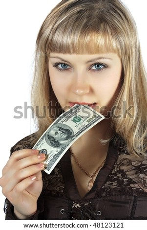 The beautiful woman bites hundred dollar banknote