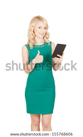 the Beautiful woman holding tablet giving thumbs up over white - stock photo