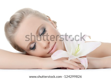 The beautiful woman with a lily flower - stock photo
