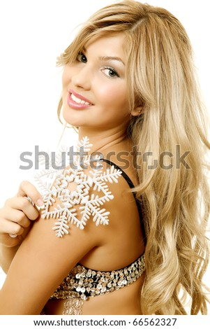The beautiful woman with a snowflake - stock photo