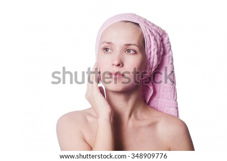 The beautiful woman with a towel on the head