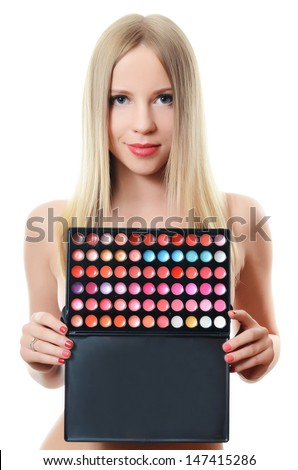 The beautiful woman with palette eye shadow - stock photo