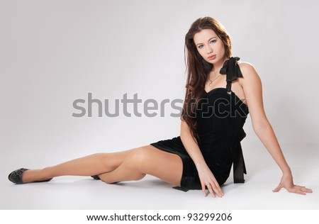 The beautiful young girl in a black dress