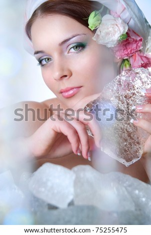 The beautiful young girl in a role of spring which heats ice. - stock photo