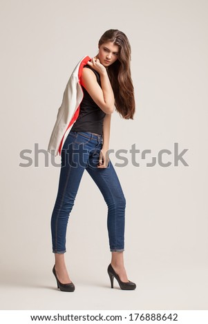 The beautiful young girl poses in studio. Clothes advertizing. Catalog ...