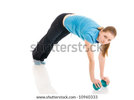 The beautiful young woman doing exercise isolated on a white background