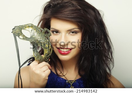 The beautiful young woman with mysterious mask  - stock photo
