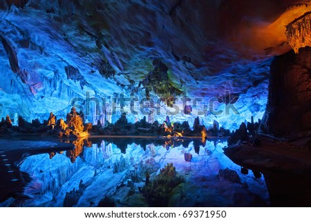 "The beautifully illuminated Reed Flute Caves displaying the ""Crystal Palace of the Dragon King"" formations. Located in Guilin, Guangxi Provine, China"