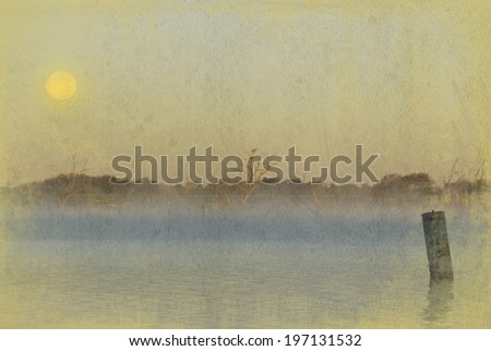 The beauty of the early morning mist rising up off a lake, with the moon still in the sky. A grunge textured effect has been applied to make the photo weathered and worn looking - stock photo