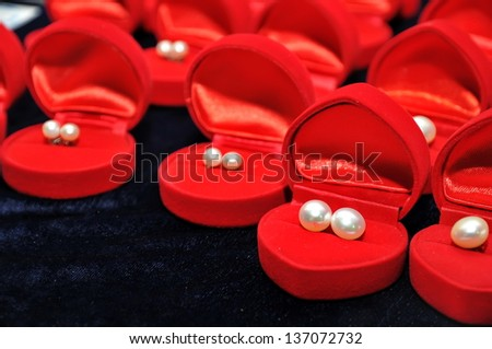 The beauty pearl earrings in the red box - stock photo