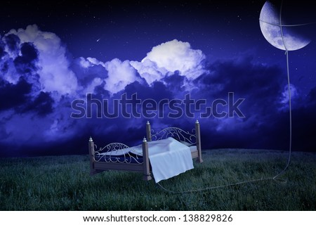 the bed raises to the meadow linked to the moon in the dream - stock photo