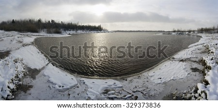 The beginning of winter and the unfrozen river . Western Siberia.October. - stock photo