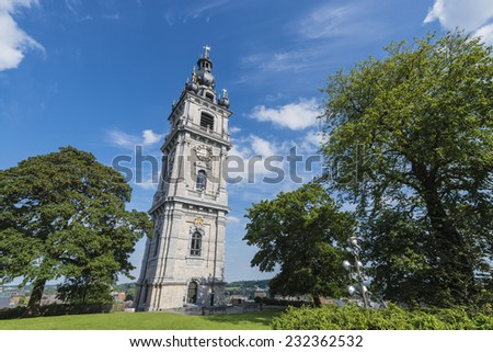 The belfry, also called El Catiau by Montois, was built in Mons in the 17th century and is the only baroque style building in Belgium that reaches a height of 87 meters. - stock photo