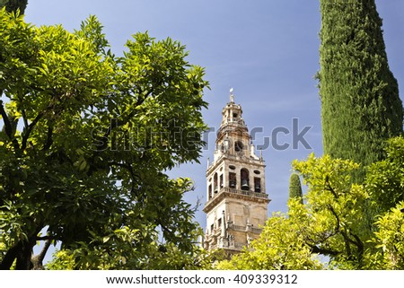 The Bell Tower, also called the Tower of Alminar, seen from the Courtyard of the Orange Trees of the Mosque-Cathedral of Cordoba, Spain - stock photo