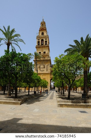 The bell tower and the Garden of Great Mosque, Cordoba, Spain - stock photo