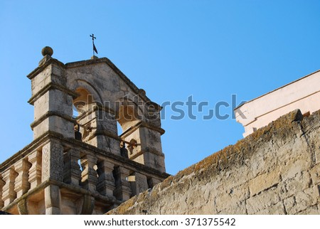 "The bell tower of an ancient church of Matera the ""Stone City"" of Basilicata in Italy"
