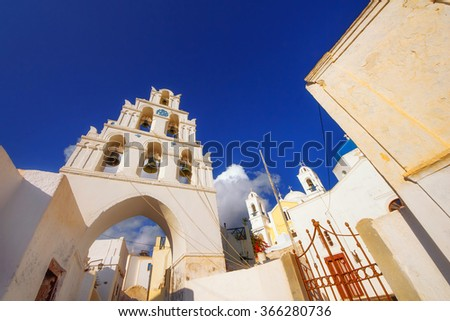 The bell tower of Megalochori village, Santorini, at sunset - stock photo