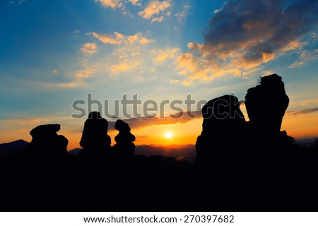 The Belogradchik Rocks at sunset, Belogradchik, Bulgaria. The Belogradchik Rocks are a group of strange shaped sandstone and conglomerate rocks located on the western slopes of the Balkan Mountains.