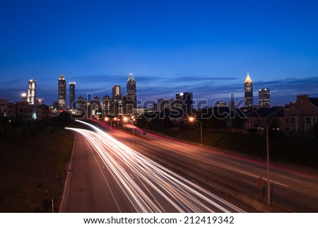 The best Atlanta Downtown overlook at dusk with traffic flow and blue sky red cloud/Atlanta downtown at dusk
