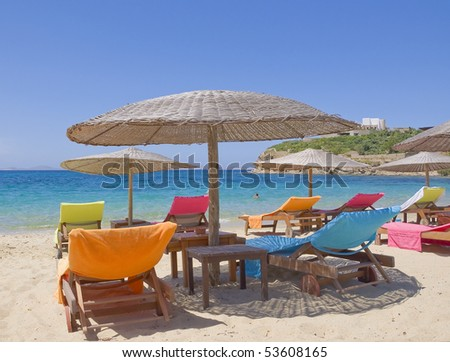 The best beaches in Europe - on the island of Mykonos with colored chaise longue and umbrellas near the sea - stock photo
