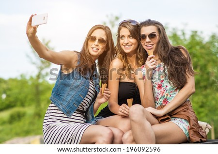 The best friends. Selfie - Three beautiful woman eating ice cream in the City - stock photo