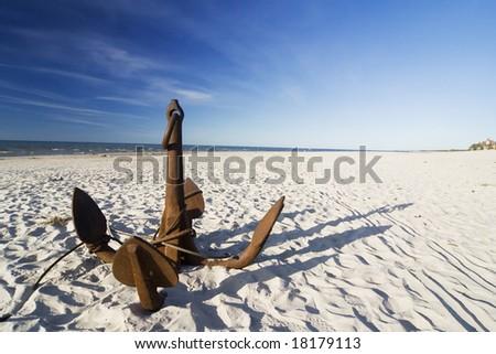 the big anchor on the sand beach - stock photo