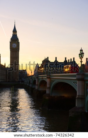 The Big Ben, and the Westminster Bridge at sunset, London, UK. - stock photo