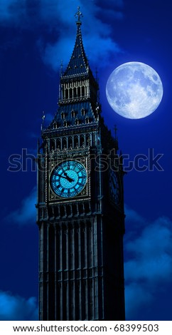 The Big Ben at night with a bright full moon - stock photo