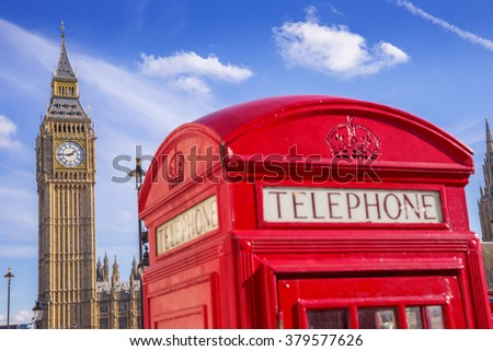 The Big Ben with famous British red telephone box on a sunny day with blue sky - London, UK - stock photo