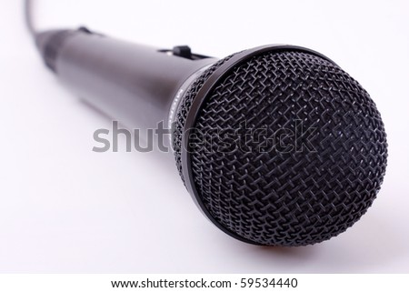 The big black microphone on a white background - stock photo