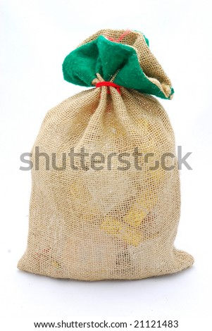 The big brown gunny sack of Santa Claus filled with lots of christmas presents isolated on white background. - stock photo