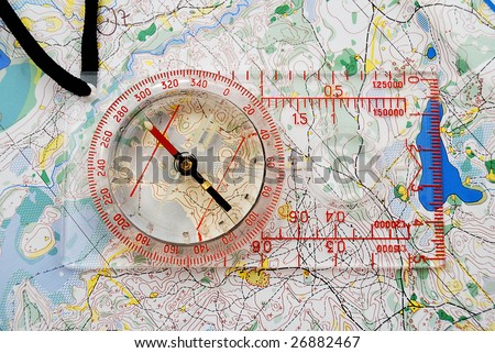 The big compass on a sports map for orientation - stock photo
