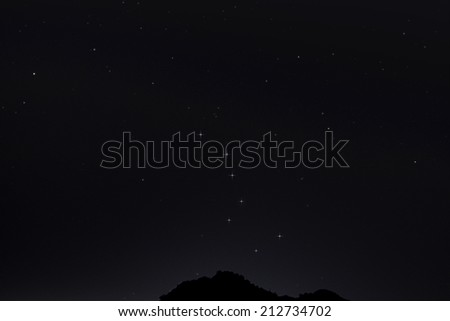 The Big Dipper About to disappear behind a mountain in Arizona - stock photo