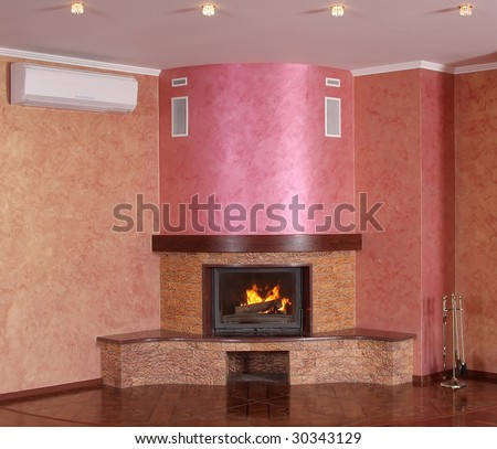 The big fireplace in a room for visitors