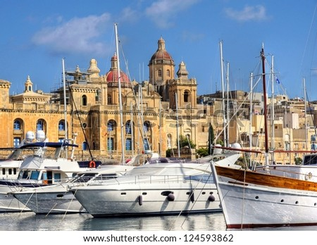 The big harbor of the city Valetta, Malta with modern yachts laying before ancient buildings