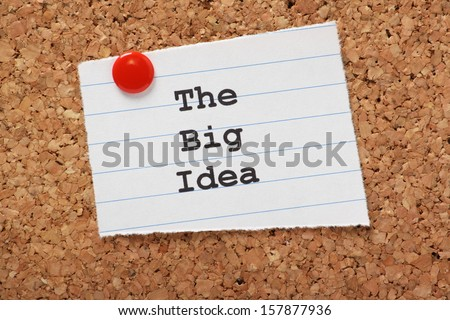 The Big Idea typed onto a scrap of lined paper and pinned to a cork notice board.  - stock photo