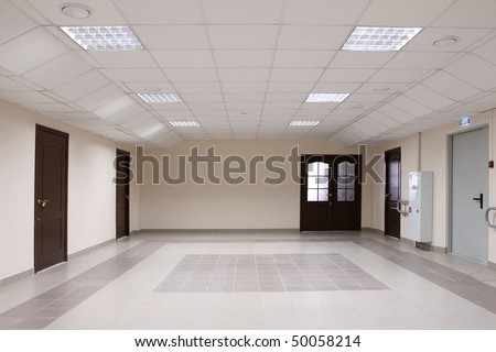 The big spacious hall which has been laid out by a tile - stock photo